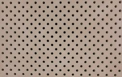 Concrete wall with small uniform drilled holes royalty free stock images