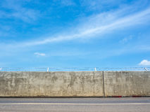 Concrete Wall Street With Barbed Wire Fence. Stock Images