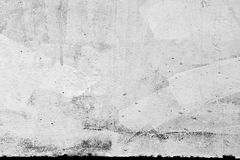 Concrete wall texture with plaster and paint. Closeup concrete wall texture with plaster and white paint Royalty Free Stock Image