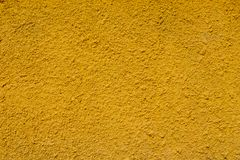 Concrete wall texture yellow color background stock photography