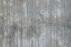 Concrete wall with traces from rubbed finish processing. Grey concrete wall with parallel traces from rubbed finish processing abrasive machining and crack check royalty free stock photos