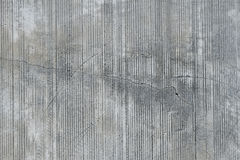 Concrete wall with traces from rubbed finish processing. Grey concrete wall with parallel traces from rubbed finish processing abrasive machining and crack check royalty free stock images