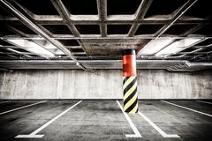 Concrete wall underground parking garage interior Stock Images