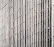 Concrete wall with vertical lines and windows Royalty Free Stock Photography