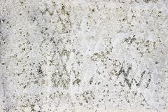 Old concrete wall with a layer of whitewash, stucco texture stock photography