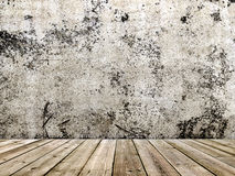 Concrete wall and wooden floor in a grunge style Stock Photos