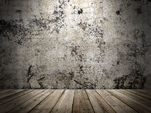 Concrete wall and wooden floor in a grunge style Royalty Free Stock Photos