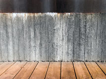 Concrete wall and wooden floor Stock Images