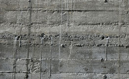 Concrete wall with wooden pattern impress from wooden form board Royalty Free Stock Photo