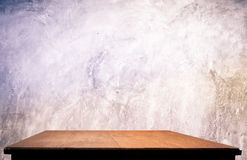 Concrete wall and wooden table Royalty Free Stock Photography