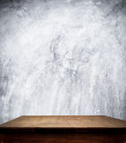 Concrete wall and wooden table Stock Photo
