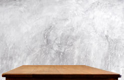 Concrete wall and wooden table Royalty Free Stock Images