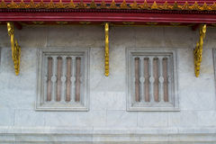 Concrete wall and wooden windows of Buddha image hall of Wat Phr Royalty Free Stock Photography