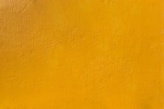 Concrete wall yellow texture background. Color of concrete wall texture background Stock Photography