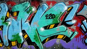 Concrete walls covered with colourful graffiti. Conceptual graffiti on urban walls in Thailand, urban art of vandalism stock footage