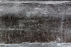 Concrete walls are painted with gloss black paint. Abstract background Stock Images
