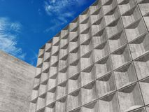 Concrete walls under blue sky. 3d Royalty Free Stock Image