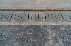 Concrete Water Drain. On sidewalk Stock Photo