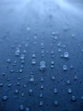 Concrete Water Drops. Water drops on a textured concrete surface Royalty Free Stock Image