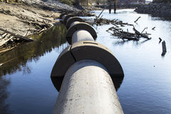Concrete Water Pipes. This is from a part of the river Tista in Halden, Norway. The concrete pipe in the picture had a leak so the river needed to be dried out Royalty Free Stock Image