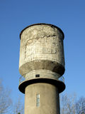 Concrete water tower. Old concrete water tower against blue sky Royalty Free Stock Image