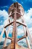 Concrete water tower. Against blue sky stock photography