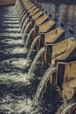 Concrete weir across river Royalty Free Stock Images