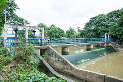 Concrete weir with bridge at the river for irrigation. River weir and bridge background royalty free stock image