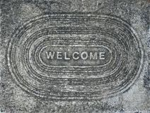 Concrete Welcome Background. Textured Concrete Welcome Mat Background Stock Photography