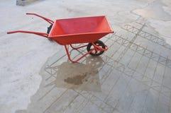 Concrete wheel barrow Stock Images