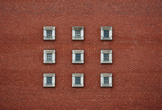 9 concrete windows square and a red brick wall Royalty Free Stock Image