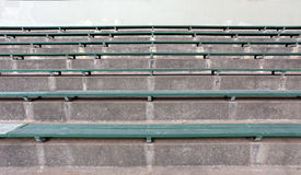 Concrete and Wood Bleachers. Rows of green wood and concrete sporting event bleachers royalty free stock photo