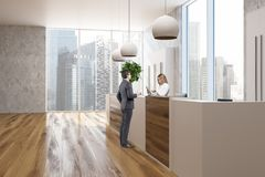 Concrete and wooden office corner reception people Royalty Free Stock Images