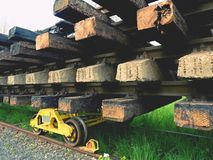 Concrete and wooden sleepers extracted  with rail rods in railway station stock waiting for transport to steel foundry Royalty Free Stock Photo
