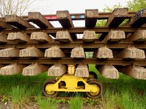 Concrete and wooden sleepers extracted  with rail rods in railway station stock waiting for transport to steel foundry Royalty Free Stock Image