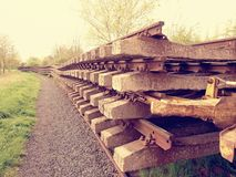 Concrete and wooden sleepers extracted  with rail rods in railway station stock waiting for transport to steel foundry Stock Photo