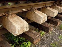 Concrete and wooden sleepers extracted  with rail rods in railway station stock waiting for transport to steel foundry Royalty Free Stock Images