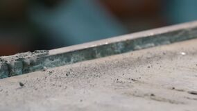 Concrete workshop - little pieces of concrete are shaking because of vibration