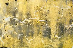 Concrete yellow and gray old dilapidated ancient flat stone wall texture with veins, divorces, patterns, cracks, pores and holes. Background Royalty Free Stock Photography