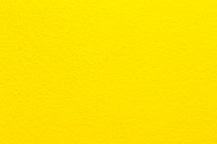 Concrete yellow wall background. Stock Photos
