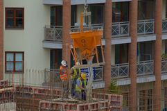 Concreting. Construction workers are concreting wall Stock Image
