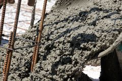 Concreting the floor of a new house,pouring concrete. Concreting the floor of a  new house,pouring concrete,image Royalty Free Stock Photos