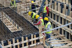Concreting formwork for the foundation. BELGRADE, SERBIA - MARCH 11, 2017: Concreting formwork for the foundation under construction, purring steel rebar Stock Image