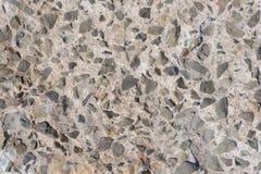 Concreto com pedras, textura Imagens de Stock