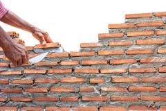 Concreto da parede da construção do pedreiro isolado no fundo branco Imagens de Stock Royalty Free