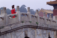 Concubine and stone bridge. A young girl in concubine dresses on the stone arched bridge, the qing west tombs, china Royalty Free Stock Images