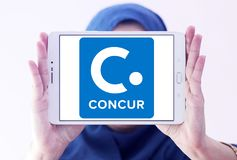 Concur Technologies logo. Logo of Concur Technologies on samsung tablet holded by arab muslim woman . Concur Technologies is an American SaaS company, providing Stock Photo