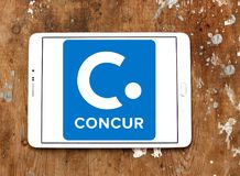 Concur Technologies logo. Logo of Concur Technologies on samsung tablet on wooden background. Concur Technologies is an American SaaS company, providing travel Stock Photography