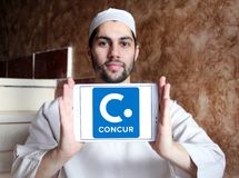 Concur Technologies logo. Logo of Concur Technologies on samsung tablet holded by arab muslim man. Concur Technologies is an American SaaS company, providing Stock Image