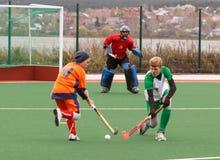 Concurrence d'hockey de champ de la jeunesse Photographie stock libre de droits